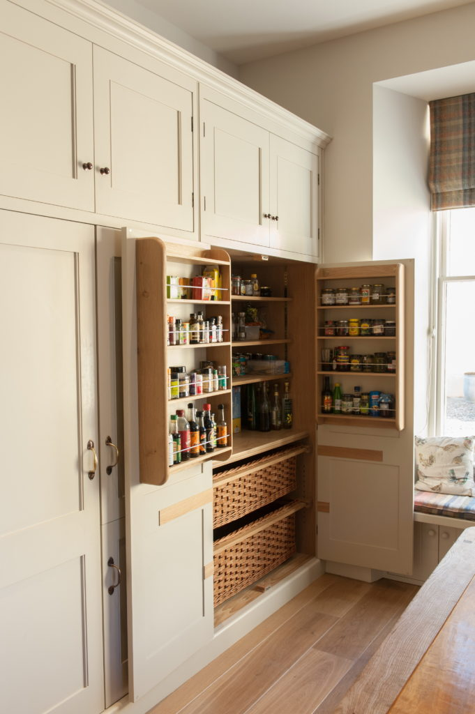 Bespoke larder cupboard with spice racks and baskets by Guild Anderson Furniture